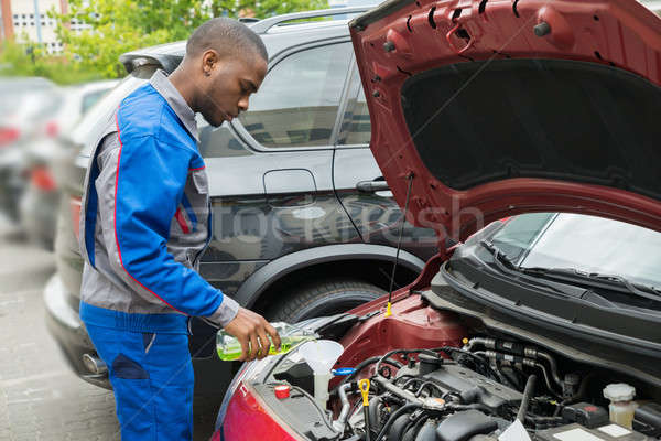 Mechanic Pouring Oil Lubricant Into The Car Stock photo © AndreyPopov