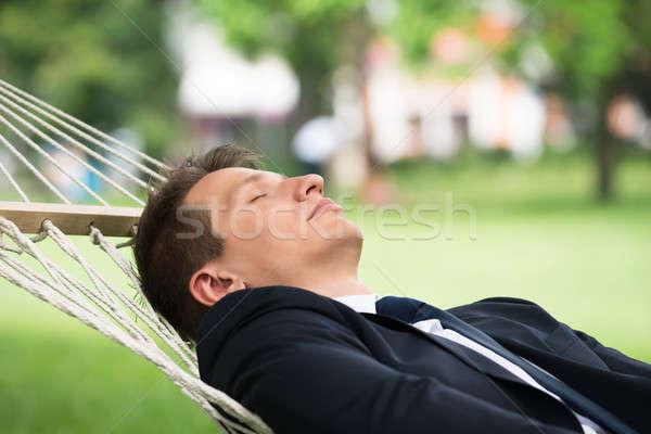 Férfi függőágy közelkép fiatalember természet üzletember Stock fotó © AndreyPopov