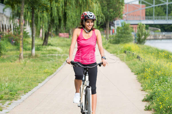 Happy Young Woman Riding Bicycle Stock photo © AndreyPopov