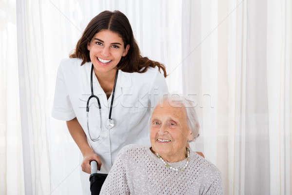 Female Doctor With Handicapped Senior Patient Stock photo © AndreyPopov