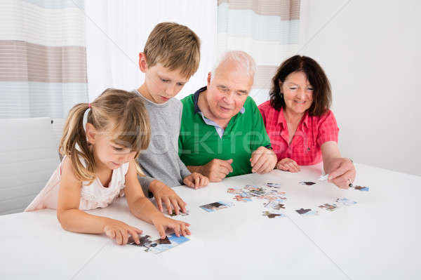 Multi Generation Family Solving Puzzle Together Stock photo © AndreyPopov
