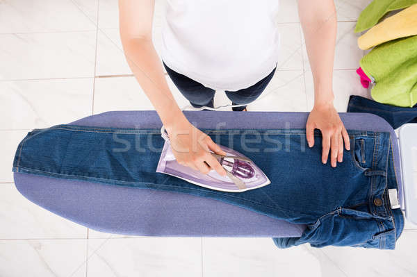 High Angle View Of Woman Ironing Jeans Stock photo © AndreyPopov