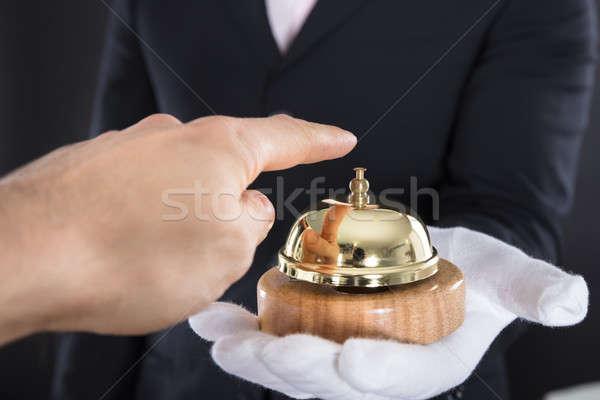 Pessoas mão serviço sino manter garçom Foto stock © AndreyPopov