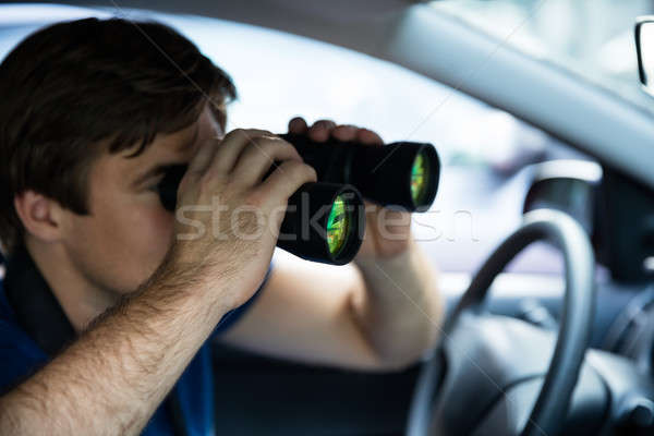 Male Looking Through Binoculars Stock photo © AndreyPopov