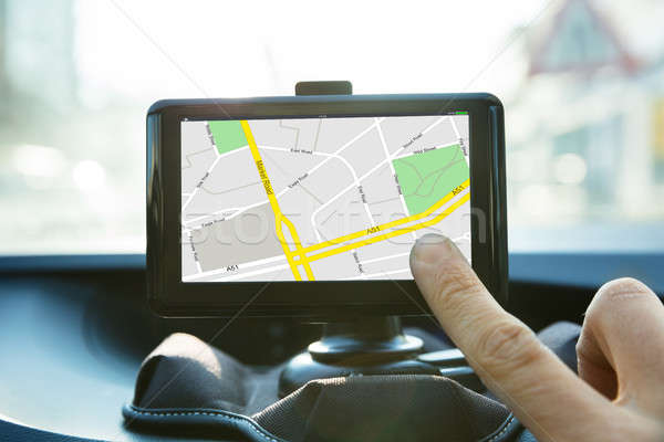 Person Operating Navigational System In Car Stock photo © AndreyPopov
