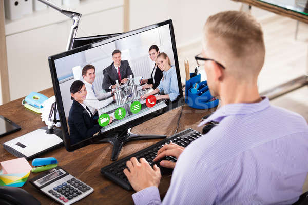 Businessman Video Conferencing On Computer Stock photo © AndreyPopov