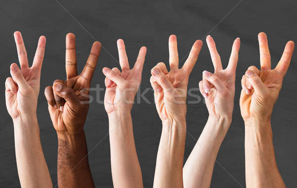 Hands Showing The Sign Of Peace Stock photo © AndreyPopov