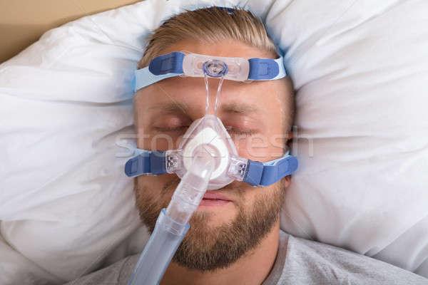 Man With Sleeping Apnea And CPAP Machine Stock photo © AndreyPopov