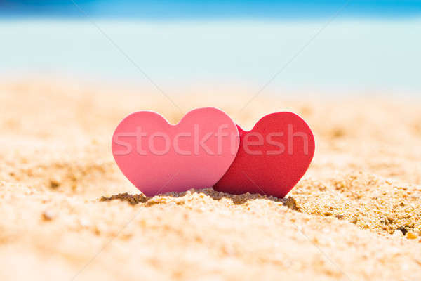 Two Hearts In Sand At Beach Stock photo © AndreyPopov
