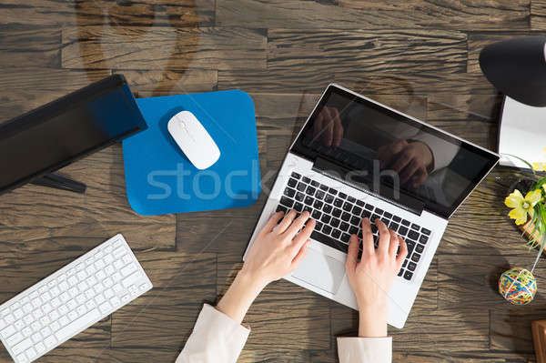 Stock photo: Businesswoman Using Laptop
