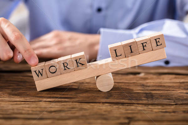 Person Showing Misbalance Between Work And Life Stock photo © AndreyPopov