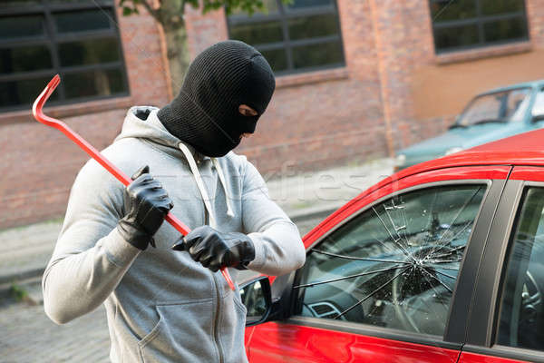 Thief Breaking Car Window With Crowbar Stock photo © AndreyPopov