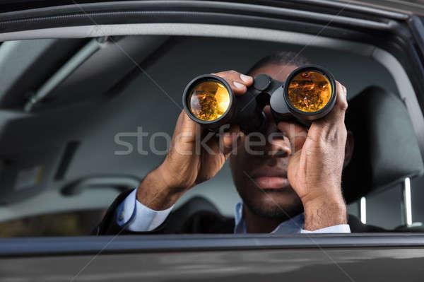 Afrikai férfi néz közelkép ül bent Stock fotó © AndreyPopov