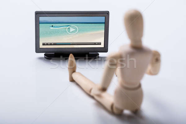 Wooden Figure Watching Video On Television Stock photo © AndreyPopov
