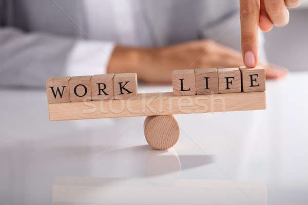 Businessperson's Finger Showing Imbalance Between Work And Life Stock photo © AndreyPopov