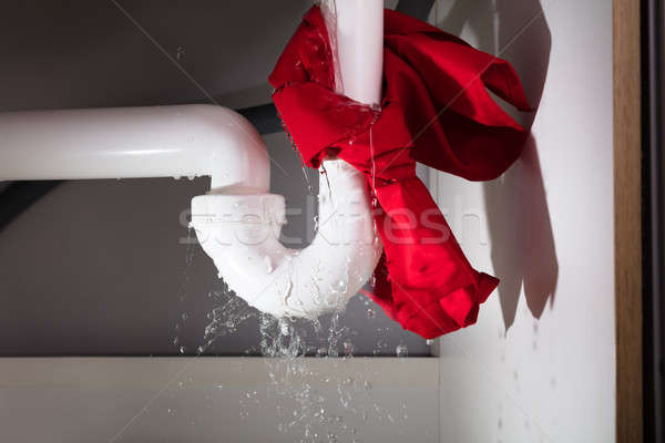 Red Napkin Tied Under The Leakage Sink Pipe Stock photo © AndreyPopov