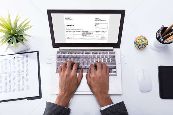 Businessperson Checking Invoice On Laptop Stock photo © AndreyPopov