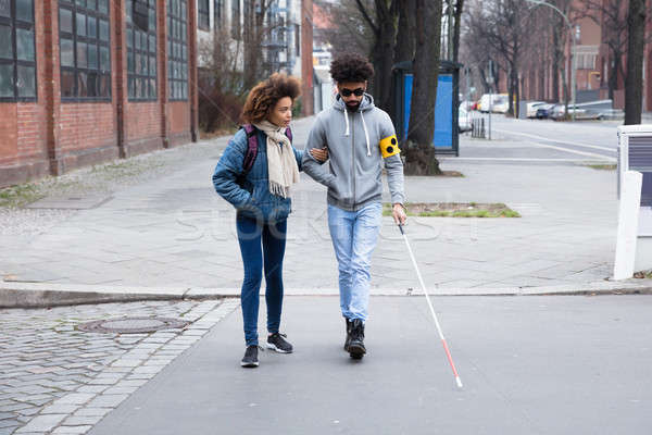 Woman Helping Blind Man While Crossing Road Stock photo © AndreyPopov