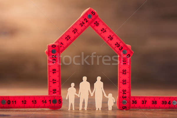Family Under The House Made With Red Measuring Tape Stock photo © AndreyPopov