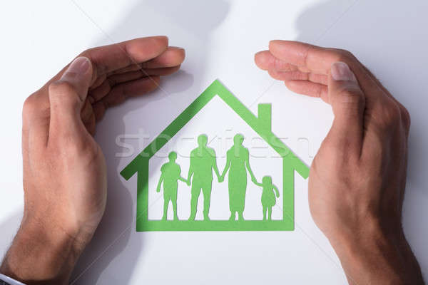 Person Protecting Family Home Stock photo © AndreyPopov