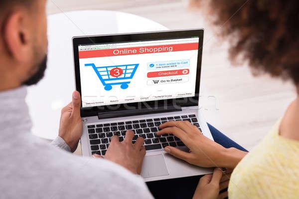 çift online alışveriş dizüstü bilgisayar araba ekran bilgisayar Stok fotoğraf © AndreyPopov