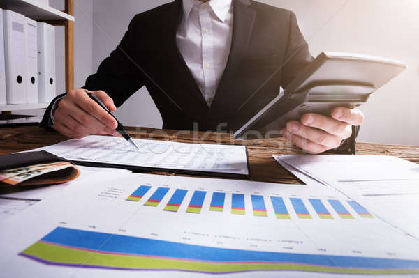 Businessperson Calculating Financial Report Stock photo © AndreyPopov
