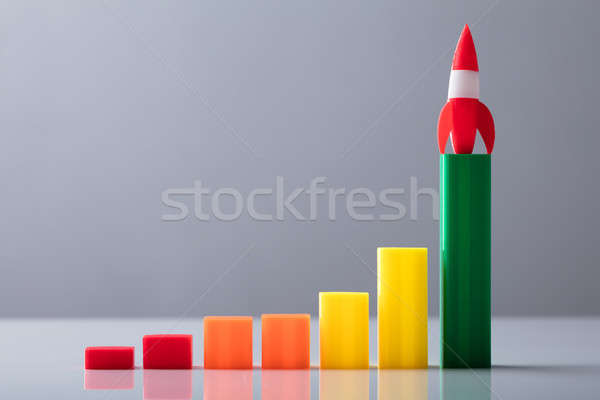 Close-up Of Red Rocket On Top Of Increasing Graph Stock photo © AndreyPopov
