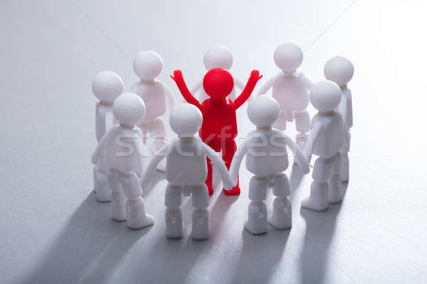 Stock photo: Red Human Figure Surrounded By Team