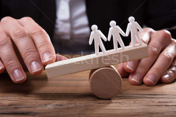 Close-up Of White Human Figures On Wooden Seesaw Stock photo © AndreyPopov