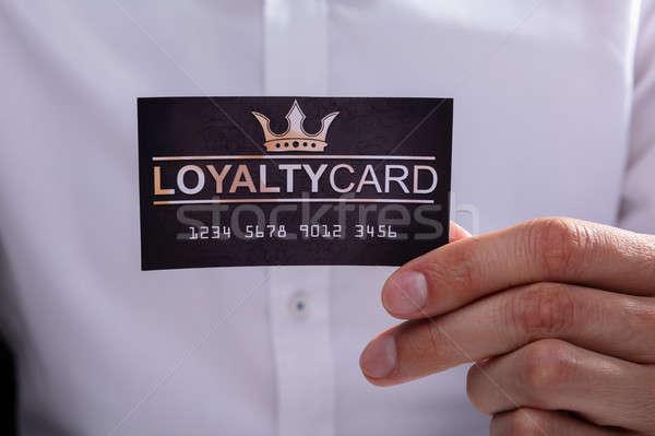 Businessman Holding Loyalty Card Stock photo © AndreyPopov