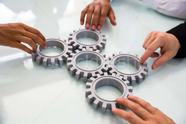 Business People's Hand Connecting Gears Stock photo © AndreyPopov