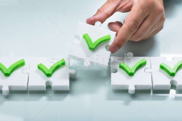 Person arranging check mark sign in a row Stock photo © AndreyPopov