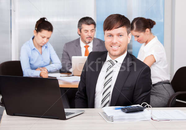 Businessman Working At Office Stock photo © AndreyPopov