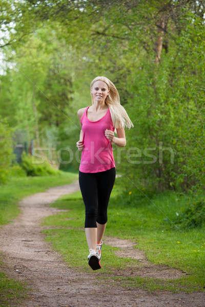 Feliz correr retrato parque árbol Foto stock © AndreyPopov