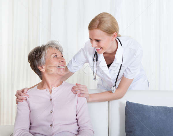 Portrait Of Doctor And Patient Sitting On Couch Stock photo © AndreyPopov