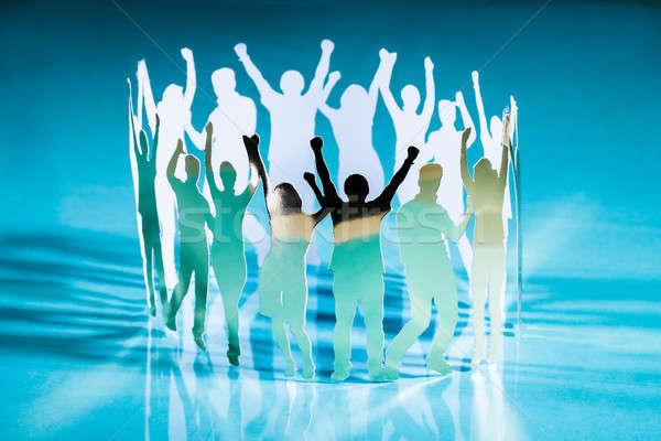 Sziluettek emberek áll kör kezek buli Stock fotó © AndreyPopov