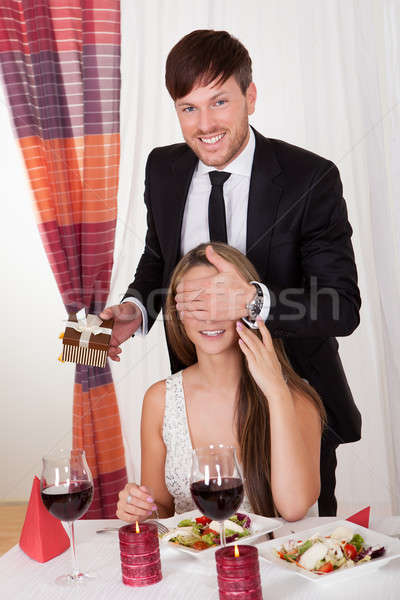 Man surprising his wife with a gift Stock photo © AndreyPopov