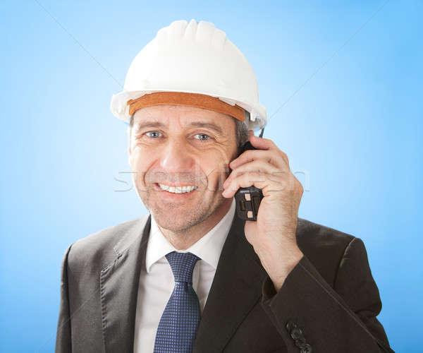 Senior architect talking on walkie-talkie Stock photo © AndreyPopov
