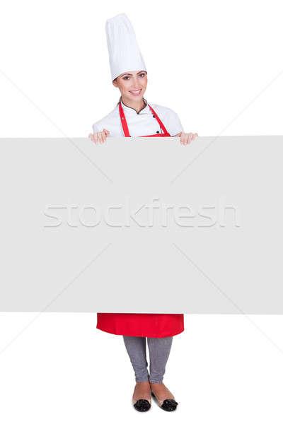 Boldog női szakács tart plakát izolált Stock fotó © AndreyPopov