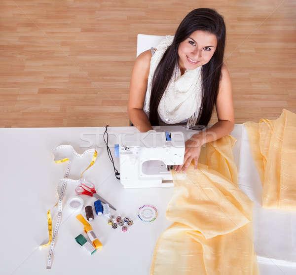 女性 作業 ミシン 笑みを浮かべて 若い女性 長い ストックフォト © AndreyPopov