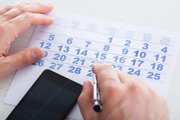 Main stylo calendrier téléphone portable Photo stock © AndreyPopov