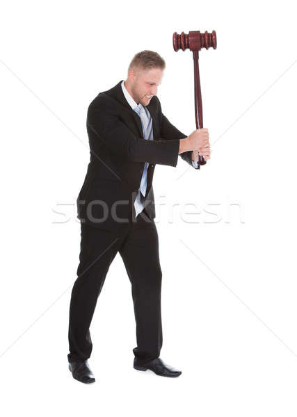 Businessman wielding a big wooden mallet Stock photo © AndreyPopov