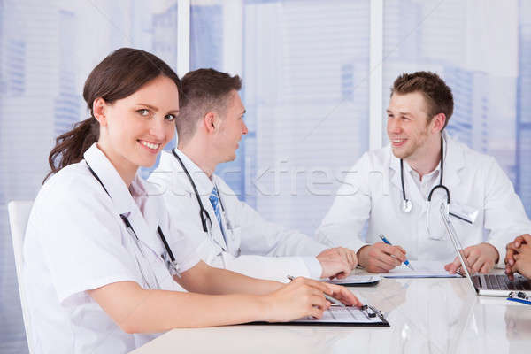 Happy Female Doctor In Board Meeting Stock photo © AndreyPopov