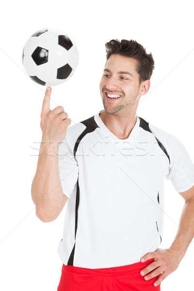 Futbolista pelota sonriendo jóvenes aislado blanco Foto stock © AndreyPopov