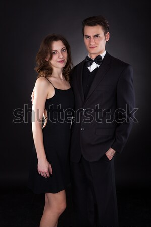 Man Kissing Woman On Neck While Removing Dress Strap Stock photo © AndreyPopov