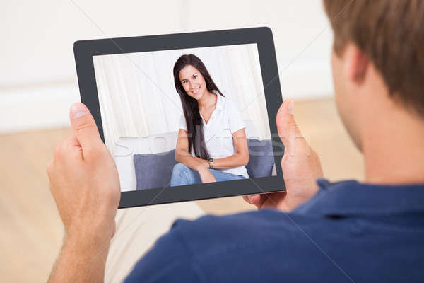 Man Video Chatting With Woman Stock photo © AndreyPopov