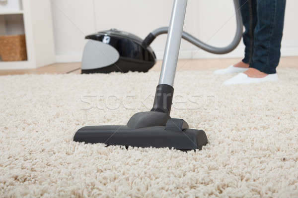 Low Section Of Woman Vacuuming Floor Stock photo © AndreyPopov