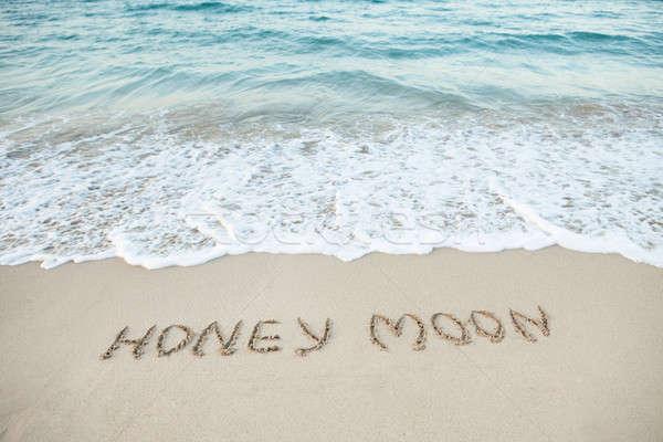 Woord huwelijksreis geschreven strand zand water Stockfoto © AndreyPopov