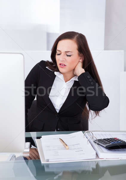 Tax Consultant Suffering From Neck Pain Stock photo © AndreyPopov