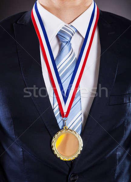 бизнесмен медаль черный золото успех Сток-фото © AndreyPopov
